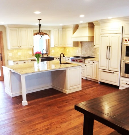 New Hard Wood Plank Kitchen Flooring and Updated Cream Kitchen Cabinets