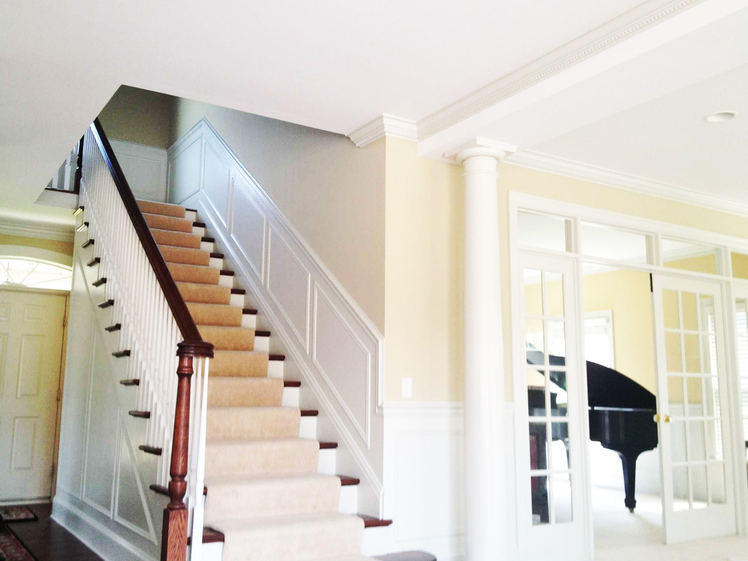 Refinished Staircase Using Dark Hardwood and Carpet and French Doors Going into Bonus Music Room