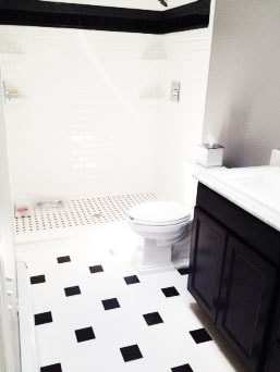 Contemporary Black and White Bathroom Renovation with Updated Bathroom Cabinets and White Porcelain Sink