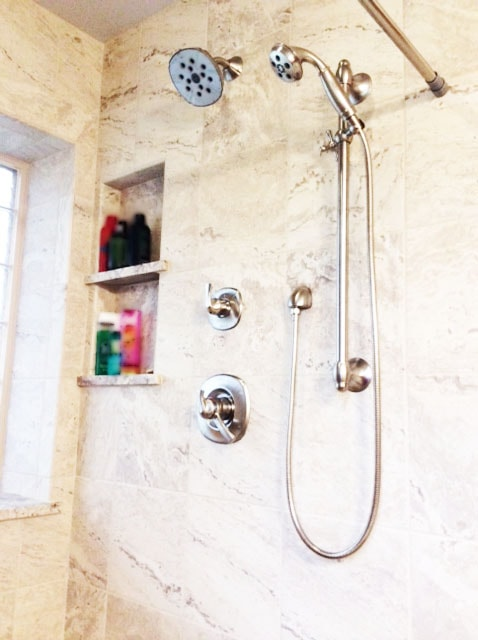 Shower Update with Marbled Ceramic Tiles and Stainless-Steel Shower Features