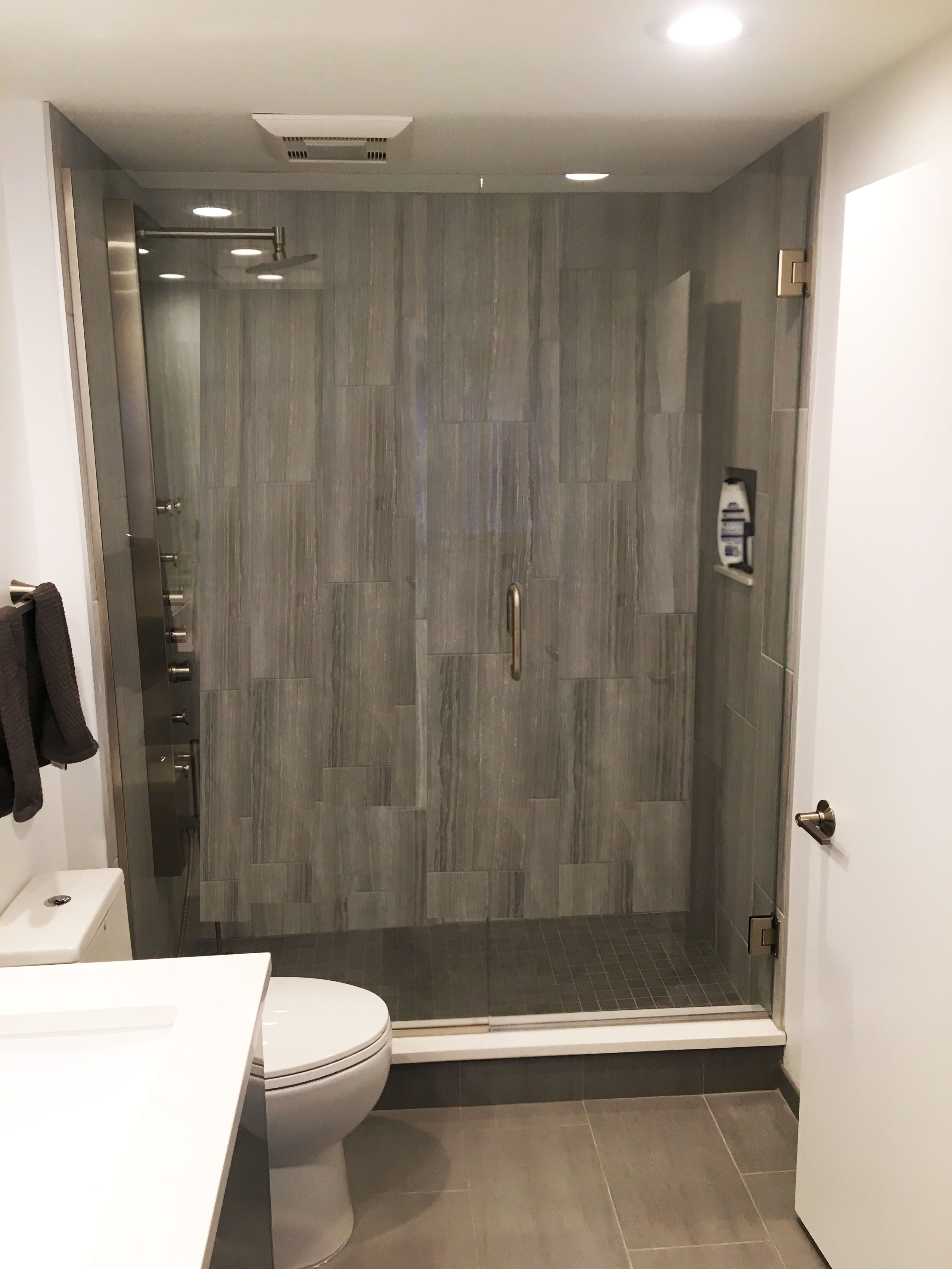 Modern Bathroom Renovation with Stainless Steel Fixtures and Ceramic Tile Surround