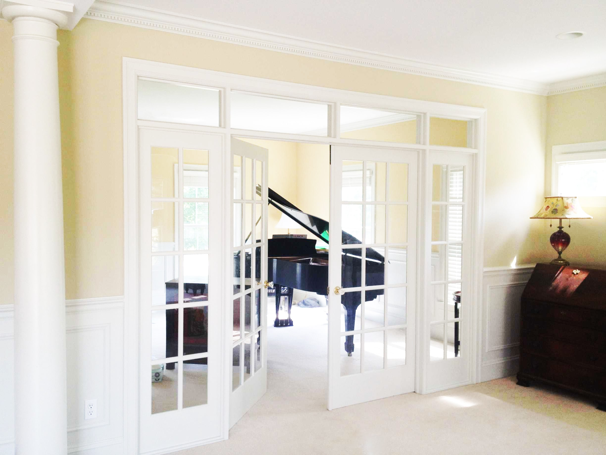 Glass Panel French Doors Opening into Bonus Sunroom